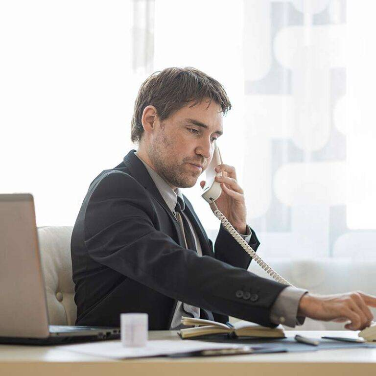 employee-using-desk-phone